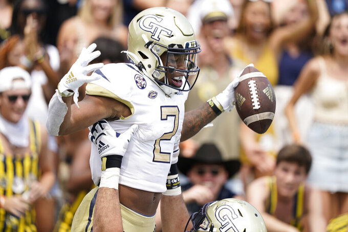 Georgia Tech wide receiver Kyric McGowan (2) is lifted up by offensive lineman Devin Cochran (77) after McGowan scored a touchdown during the second half of an NCAA college football game against Kennesaw State, Saturday, Sept. 11, 2021, in Atlanta. (AP Photo/Brynn Anderson)
