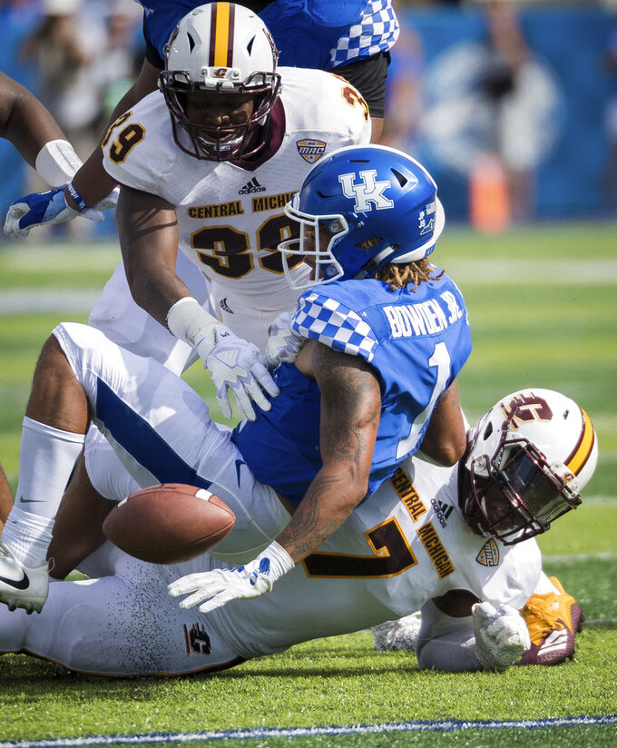 Kentucky wide receiver Lynn Bowden Jr. (1) fumbles the ball during an NCAA college football game against Central Michigan in Lexington, Ky., Saturday, Sept. 1, 2018. (AP Photo/Bryan Woolston)