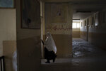 A girl walks into her classroom at a school in Kabul, Afghanistan, Sunday, Sept. 12, 2021. (AP Photo/Felipe Dana)