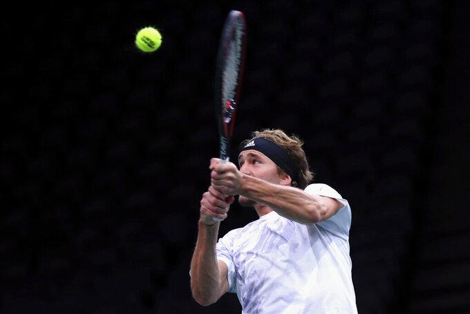 Germany's Alexander Zverev returns the ball to Spain's Rafael Nadal during their semi-final game of the Paris Masters tennis tournament in Paris, Saturday, Nov. 7, 2020. (AP Photo/Thibault Camus)