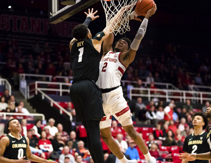 Colorado guard Tyler Bey (1) defends against a shot by Stanford guard Bryce Wills (2) during the first half of an NCAA college basketball game in Stanford, Calif., Saturday, Jan. 26, 2019. (AP Photo/John Hefti)