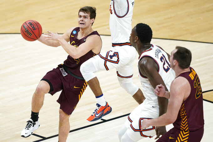 Loyola of Chicago's Braden Norris, left, drives against Illinois during the first half of a college basketball game in the second round of the NCAA tournament at Bankers Life Fieldhouse in Indianapolis Sunday, March 21, 2021. (AP Photo/Mark Humphrey)