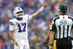 Buffalo Bills quarterback Josh Allen (17) expresses himself to side judge Allen Baynes (56) during the second half of an NFL football game against the Pittsburgh Steelers in Orchard Park, N.Y., Sunday, Sept. 12, 2021. (AP Photo/Joshua Bessex)