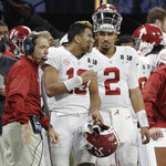FILE - In this Jan. 8, 2018, file photo, Alabama quarterbacks Jalen Hurts (2) and Tua Tagovailoa (13) and head coach Nick Saban watch from the sideline during the second half of the NCAA college football playoff championship game against Georgia in Atlanta. (AP Photo/David J. Phillip)