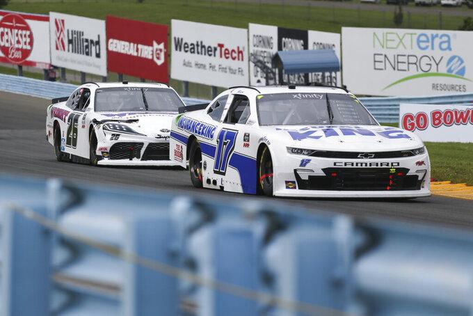 Josh Bilicki (17) and Kris Wright (26) drive along the Esses in the NASCAR Xfinity Series auto race at Watkins Glen International in Watkins Glen, N.Y., on Saturday, Aug. 7, 2021. (AP Photo/Joshua Bessex)