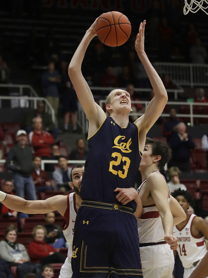 California center Connor Vanover (23) shoots against Stanford's Josh Sharma, left, and Cormac Ryan during the second half of an NCAA college basketball game in Stanford, Calif., Thursday, March 7, 2019. (AP Photo/Jeff Chiu)