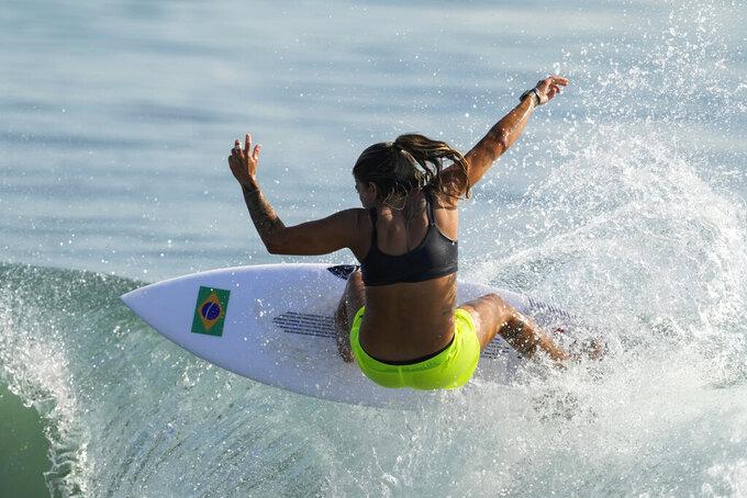 Brazil's Silvana Lima rides a wave during a training session at the 2020 Summer Olympics, Saturday, July 24, 2021, at Tsurigasaki beach in Ichinomiya, Japan. (AP Photo/Francisco Seco)
