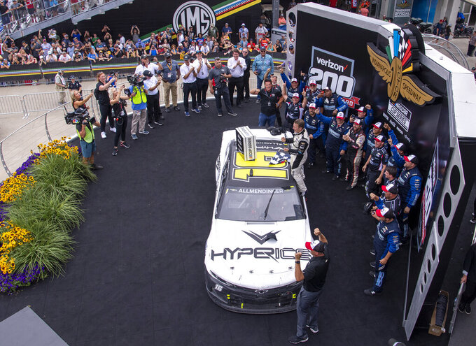AJ Allmendinger (16) reacts after winning a NASCAR Cup Series auto race at Indianapolis Motor Speedway, Sunday, Aug. 15, 2021, in Indianapolis. (AP Photo/Doug McSchooler)