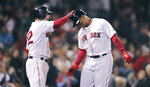 Boston Red Sox's Rafael Devers, right, is congratulated by Andrew Benintendi after his solo home run off San Francisco Giants starting pitcher Jeff Samardzija during the sixth inning of a baseball game at Fenway Park in Boston, Wednesday, Sept. 18, 2019. (AP Photo/Charles Krupa)