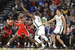 Georgia guard Anthony Edwards, left, is defended by Vanderbilt's Maxwell Evans (3) and Dylan Disu (1) in the second half of an NCAA college basketball game Saturday, Feb. 22, 2020, in Nashville, Tenn. (AP Photo/Mark Humphrey)