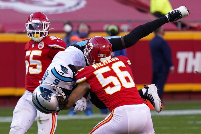 Carolina Panthers quarterback Teddy Bridgewater (5) is tackled by Kansas City Chiefs linebacker Ben Niemann (56) during the second half of an NFL football game in Kansas City, Mo., Sunday, Nov. 8, 2020. (AP Photo/Jeff Roberson)