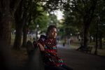 Alyssa Harris, 18, a member of the Mashpee Wampanoag Tribe, sits for a portrait in a park in Boston, Friday, Oct. 2, 2020.