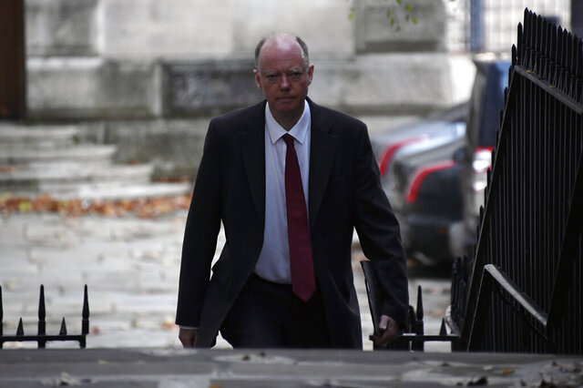 Chief Medical Officer Professor Chris Whitty arrives at 10 Downing Street, before Britain's Prime Minister Boris Johnson's speaks press conference, London, Saturday, Oct. 31, 2020. (AP Photo/Alberto Pezzali, pool)
