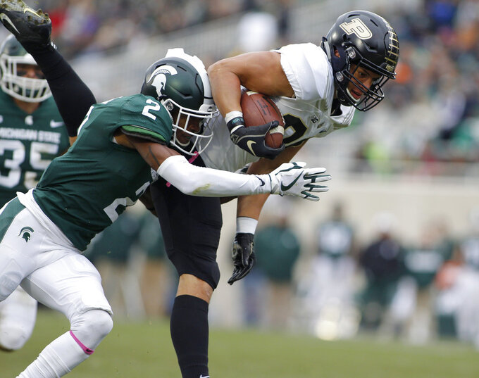 Purdue's Brycen Hopkins, right, is brought down by Michigan State's Justin Layne (2) on a pass reception during the first quarter of an NCAA college football game, Saturday, Oct. 27, 2018, in East Lansing, Mich. (AP Photo/Al Goldis)