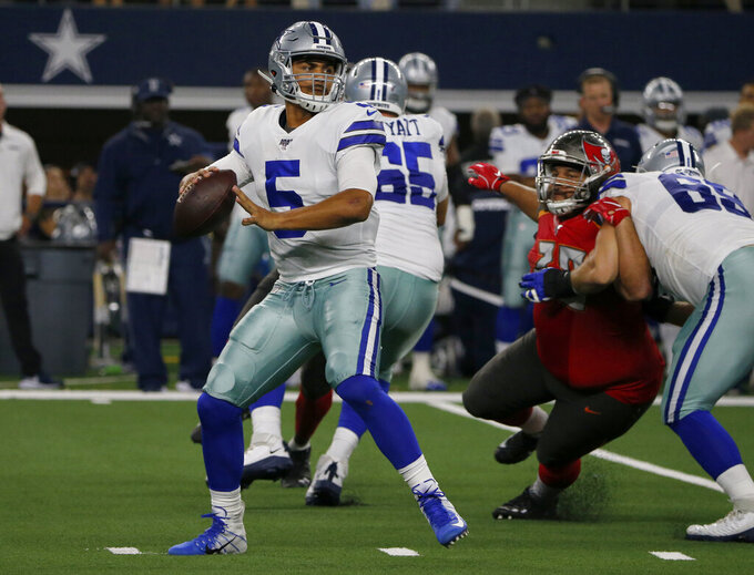 Dallas Cowboys quarterback Taryn Christion (5) prepares to throw a pass in the second half of a preseason NFL football game against the Tampa Bay Buccaneers in Arlington, Texas, Thursday, Aug. 29, 2019. (AP Photo/Michael Ainsworth)