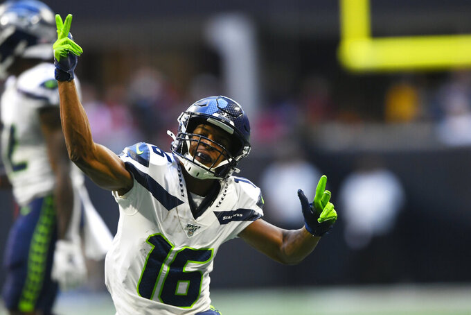 Seattle Seahawks wide receiver Tyler Lockett (16) celebrates a first down against the Atlanta Falcons during the first half of an NFL football game, Sunday, Oct. 27, 2019, in Atlanta. (AP Photo/John Amis)