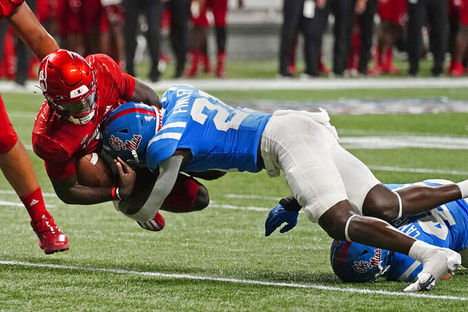 Louisville quarterback Malik Cunningham (3) is brought down by Mississippi defensive back AJ Finley (21) during the second half of an NCAA college football game Monday, Sept. 6, 2021, in Atlanta. (AP Photo/John Bazemore)