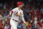 St. Louis Cardinals' Dylan Carlson celebrates as he rounds the bases after hitting a grand slam during the eighth inning of a baseball game against the San Diego Padres Friday, Sept. 17, 2021, in St. Louis. (AP Photo/Jeff Roberson)