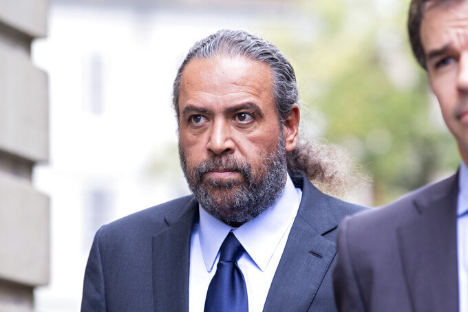 Sheikh Ahmad al-Fahad al-Sabah arrives at a Geneva's courthouse ahead of the verdict for a trial for forgery in connection with arbitration, in Geneva, Switzerland, Friday, Sept. 10, 2021. (Salvatore Di Nolfi/Keystone via AP)