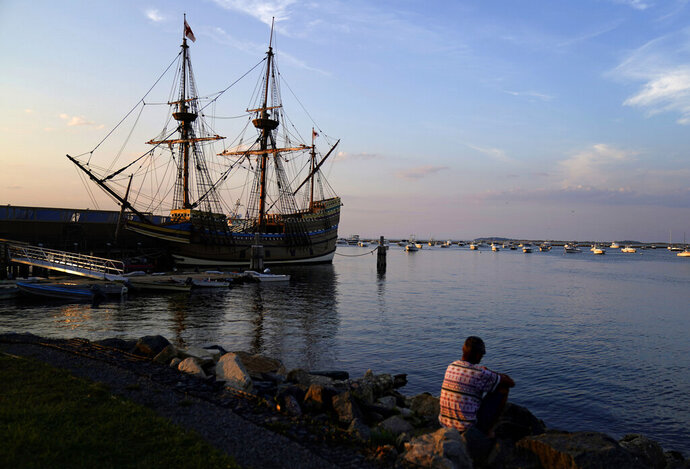 The Mayflower II, a replica of the original Mayflower ship that brought the Pilgrims to America 400 year ago, is docked in Plymouth, Mass., days after returning home following extensive renovations, Wednesday, Aug. 12, 2020. A disease outbreak that wiped out large numbers of the Native inhabitants of what is now New England gave the Pilgrims a beachhead in the