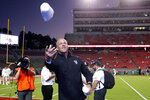North Carolina State coach Dave Doeren tosses T-shirts to the student section before the team's NCAA college football game against Syracuse in Raleigh, N.C., Thursday, Oct. 10, 2019. (AP Photo/Karl B DeBlaker)