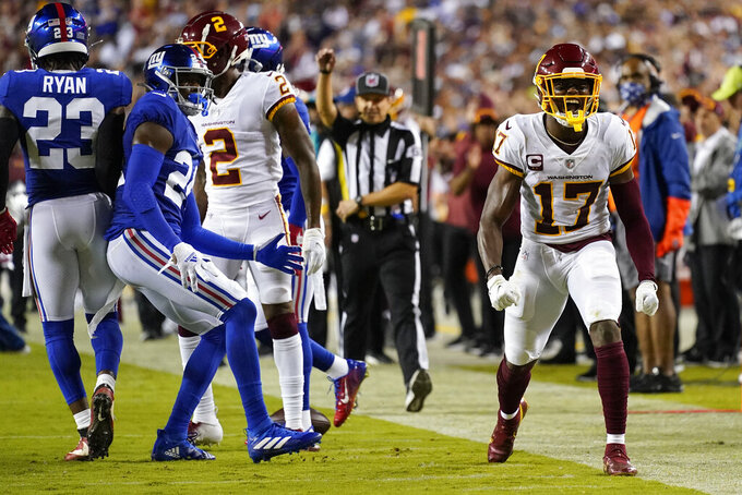 Washington Football Team wide receiver Terry McLaurin (17) celebrating his first down catch against the New York Giants during the first half of an NFL football game, Thursday, Sept. 16, 2021, in Landover, Md. (AP Photo/Patrick Semansky)