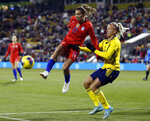 United States forward Tobin Heath, left, passes the ball in front of Sweden defender Hanna Glas during the first half of a women's international friendly soccer match in Columbus, Ohio, Thursday, Nov. 7, 2019. (AP Photo/Paul Vernon)