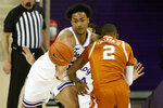 TCU forward Chuck O'Bannon Jr. (5) fouls Texas guard Matt Coleman III (2) during the second half of an NCAA college basketball game in Fort Worth, Texas, Sunday, March 7, 2021. (AP Photo/Michael Ainsworth)