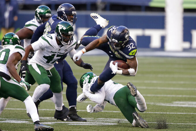 Seattle Seahawks running back Chris Carson (32) is upended on a carry against the New York Jets during the second half of an NFL football game, Sunday, Dec. 13, 2020, in Seattle. (AP Photo/Lindsey Wasson)