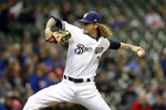 Milwaukee Brewers' Josh Hader pitches during the ninth inning of a baseball game against the Washington Nationals, Wednesday, May 8, 2019, in Milwaukee. (AP Photo/Aaron Gash)