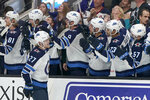 Winnipeg Jets left wing Nikolaj Ehlers (27) celebrates with teammates after scoring a goal against the San Jose Sharks during the third period of an NHL hockey game in San Jose, Calif., Friday, Nov. 1, 2019. The Jets won 3-2. (AP Photo/Tony Avelar)a