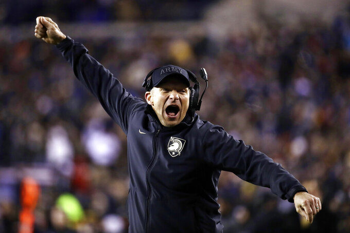 FILE - In this Dec. 8, 2018, file photo, Army head coach Jeff Monken cheers during the second half an NCAA college football game against the Navy in Philadelphia. The 120th Army-Navy game is set for Saturday in Philadelphia.  Army is trying to win its fourth straight game in the series. (AP Photo/Matt Rourke, File)