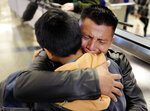 David Xol-Cholom, of Guatemala hugs his son Byron at Los Angeles International Airport as they reunite after being separated about one and half years ago during the Trump administration's wide-scale separation of immigrant families, Wednesday, Jan. 22, 2020, in Los Angeles. (AP Photo/Ringo H.W. Chiu)