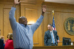 Dontae Sharpe enters a Pitt County courtroom to the cheers of his family after a judge determined he could be set free on a $100,000 unsecured bond on Thursday, Aug. 22, 2019 in Greenville, N.C. Sharpe, a North Carolina man who maintained his innocence even as he served a life sentence for a murder he didn't commit said Thursday that he got his strength in prison from God and his mother. (Deborah Griffin/The Daily Reflector via AP)