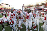 Indiana players celebrate with supporters after their 38-31 win over Nebraska in an NCAA college football game in Lincoln, Neb., Saturday, Oct. 26, 2019. (AP Photo/Nati Harnik)
