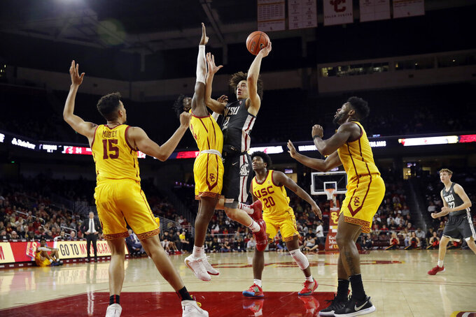 Washington State's CJ Elleby tries through shoot over a group of Southern California defenders during the second half of an NCAA college basketball game Saturday, Feb. 15, 2020, in Los Angeles. (AP Photo/Marcio Jose Sanchez)