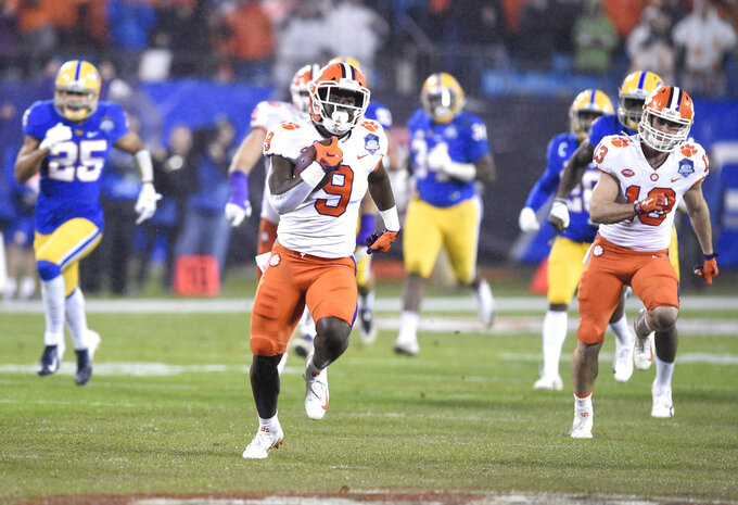 Clemson's Travis Etienne (9) runs for a touchdown against Pittsburgh in the first half of the Atlantic Coast Conference championship NCAA college football game in Charlotte, N.C., Saturday, Dec. 1, 2018. (AP Photo/Mike McCarn)