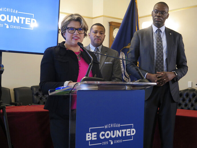 Kerry Ebersole Singh, left, Michigan's statewide census director, helps to announce the kickoff of