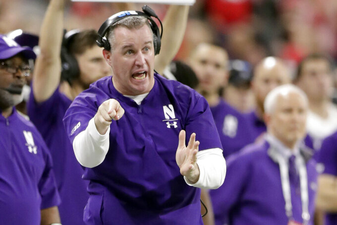FILE - In this Dec. 1, 2018, file photo, Northwestern head coach Pat Fitzgerald directs his team from the sidelines during the second half of the Big Ten championship NCAA college football game against Ohio State in Indianapolis. It seems no one is talking about Northwestern even though it won the Big Ten West last year. The chatter surely will start if the Wildcats beat the Cardinal on the road Saturday.  (AP Photo/Michael Conroy, File)