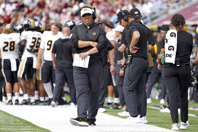 Missouri head coach Eliah Drinkwitz looks on from the sideline during the second half of an NCAA college football game against Boston College, Saturday, Sept. 25, 2021, in Boston. (AP Photo/Mary Schwalm)