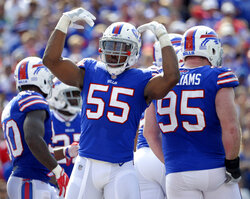 FILE - In this Sunday, Sept. 10, 2017 file photo, Buffalo Bills defensive end Jerry Hughes (55) urges the crowd during the second half of an NFL football game against the New York Jets in Orchard Park, N.Y. The Buffalo Bills have signed defensive end Jerry Hughes to a two-year contract extension worth up to $23 million. A person with direct knowledge of the contract told The Associated Press that Hughes will be guaranteed about $19 million, and could make as much as $23 million should he meet all the incentives. The person spoke on the condition of anonymity because the Bills did not release the contract's value.(AP Photo/Adrian Kraus, File)
