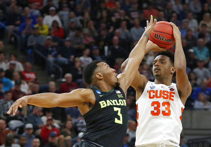 Syracuse forward Elijah Hughes (33) shoots as Baylor guard King McClure (3) defends during the first half of a first-round game in the NCAA men's college basketball tournament Thursday, March 21, 2019, in Salt Lake City. (AP Photo/Rick Bowmer)
