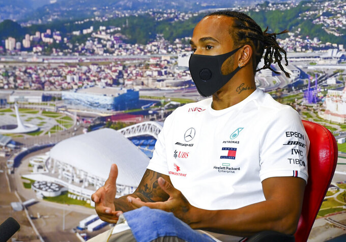 Mercedes driver Lewis Hamilton of Britain attends a media conference prior to the Russian Formula One Grand Prix, at the Sochi Autodrom circuit, in Sochi, Russia, Thursday, Sept. 24, 2020. The Russian Formula One Grand Prix will take place on Sunday, Sept. 27, 2020. (Mark Sutton, Pool via AP)