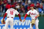 Philadelphia Phillies' Didi Gregorius, left, and Bryce Harper celebrate after a baseball game against the Pittsburgh Pirates, Friday, Sept. 24, 2021, in Philadelphia. (AP Photo/Matt Slocum)