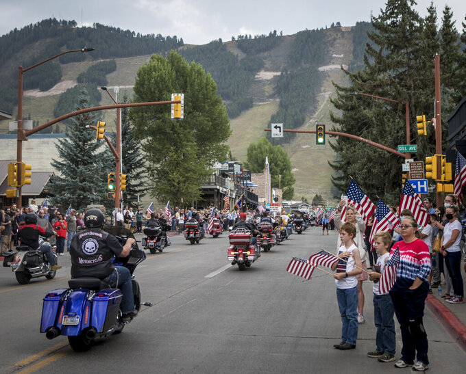 Community members honor Marine Lance Cpl. Rylee McCollum during a procession in Jackson, Wyo., Friday, Sept. 10, 2021. McCollum was one of the service members killed in Afghanistan after a suicide bomber attacked Hamid Karzai International Airport on Aug. 26. (AP Photo/Amber Baesler)