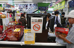 A notice calling for a boycott of Japanese-made products is displayed at a store in Seoul, South Korea, Tuesday, July 9, 2019. Japan said Tuesday it does not plan to retract or renegotiate its stricter controls on high-tech exports to South Korea, a day after the South Korean president urged that the issue be resolved through diplomacy. The signs read: