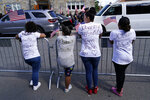 Well wishers wear t-shirts bearing messages of gratitude for Sgt. Johanny Rosario Pichardo, a U.S. Marine who was among 13 service members killed in a suicide bombing in Afghanistan, outside a funeral home in Lawrence, Mass, Saturday, Sept. 11, 2021. (AP Photo/Robert F. Bukaty)