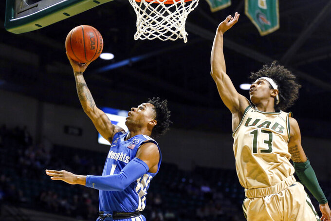 Memphis guard Tyler Harris (1) puts up a shot around UAB guard Jalen Benjamin (13) during the first half of an NCAA college basketball game Saturday, Dec. 7, 2019, in Birmingham, Ala. (AP Photo/Butch Dill)
