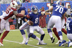 New York Giants quarterback Daniel Jones, center, tries to evade the Arizona Cardinals defense during the second half of an NFL football game, Sunday, Oct. 20, 2019, in East Rutherford, N.J. (AP Photo/Bill Kostroun)