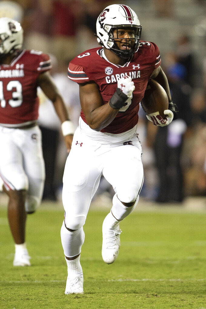 South Carolina defensive end Jordan Burch (3) returns an interception during the second half of an NCAA college football game against Eastern Illinois, Saturday, Sept. 4, 2021, in Columbia, S.C. (AP Photo/Hakim Wright Sr.)